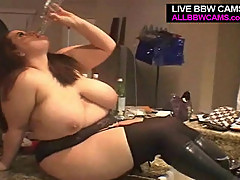 BBW poses in the kitchen