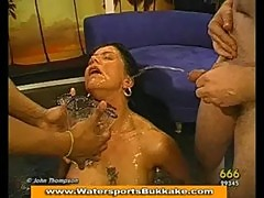 Brunette takes golden shower and drinks piss
