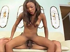 A big cock slides into her black body
