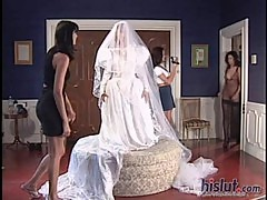 The bride is trying on her dress and gett ...