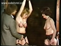 Milf slave with her tits tied together and large needles in