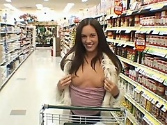 Brunette chick flashes boobs in grocery store