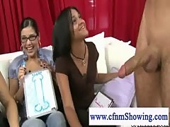 Cfnm babes plays with naked mans cock