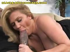 Blonde Mature Tries Her Best To Gives This Huge Black Cock A Blowjob