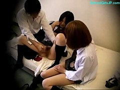 2 Schoolgirls Fingered By One Guy On The Bed