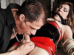 Submissive Shemale Sex Slut in Red Latex