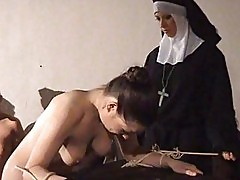 Brunette gets bondaged and whipped by a nun