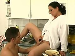 Hairy pussy mom in the kitchen sucks dick