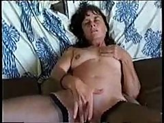 Milf rubs her clit furiously