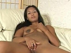 Browan Asian bitch bares pussy