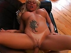 Heavy chested blonde with tattoo and pierced twat gets drill...