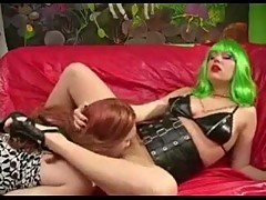 Ladyboy and girlie in latex fucking