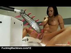 Busty babe fucks machines and squirts int ...