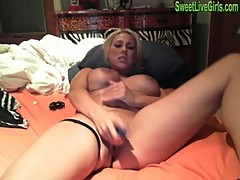 Busty blonde paying with dildo